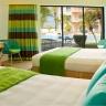 Lebello - Chair 6 seating in Aqua fibers and Sunbrella green cushion.